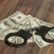 Handcuffs and money  — Stock Photo
