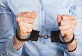 Hands in handcuffs — Stock Photo