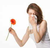 Woman having allergy from spring flowers — Stock Photo