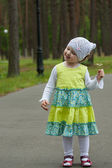 Happy smiling little girl walking in a summer park — Stock Photo