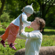 Happy mother walking with her little baby girl in a summer park — Stock Photo
