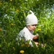 Little baby girl in a summer park — Stock Photo #22619551