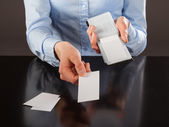 Female hands holding blank cards — Stock Photo