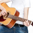 Girl playing on guitar - Stock Photo