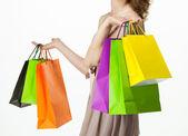 在女性手上的五彩的纸包 — 图库照片