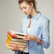 Girl holding a book - Stock Photo