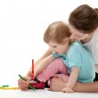 Young mother and her daughter drawing together — Stock Photo #24686571