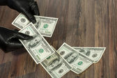 Human hands in black gloves holding dollars — Foto de Stock