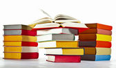 Many multicolored stacked books — Stock Photo
