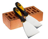 Plastering putty knives and a brick — Stock Photo