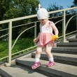 Baby girl going down the steps - Stock Photo