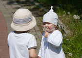 Little children in a summer park — Stock Photo