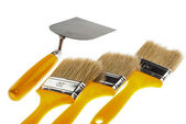 Plastering trowel and paintbrushes — Stock Photo