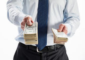 Businessman offering money to you — Stockfoto