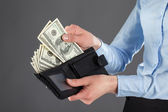 Taking money out of a leather wallet — Stock Photo