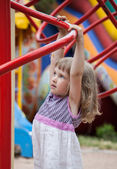 Active little girl playing in a stadium — Stock Photo