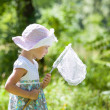 Beautiful little girl with butterfly net — Stock Photo