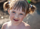Portrait of happy charming little girl — Stock Photo