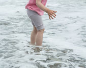 Little girl playing at the seaside — Stock Photo