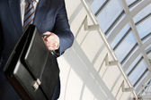 Businessman walking with a briefcase — Stock Photo