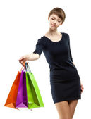 Attractive young woman holding paper bags — Stock Photo
