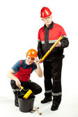 Construction workers in uniform with tools — Stock Photo