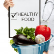 Doctor advising healthy food — Stock Photo #28716877