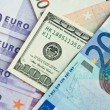 Euro and dollars banknotes — Stock Photo