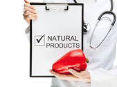 Doctor advising eating natural food — Stock Photo