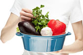 Female hands holding stew pan with fresh vegetables — Stock Photo