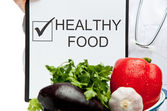 Doctor advising healthy food — Stock Photo