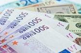Euro and dollars banknotes — Stock Photo