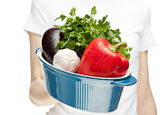 Female hand holding stew pan with fresh vegetables — Stock Photo