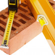Level tape line and a brick — Stock Photo
