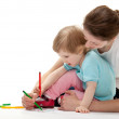 Young mother and her daughter drawing together, white background — Stock Photo #30794489