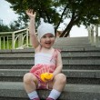 Happy baby girl sitting on steps — Stock Photo #30794747