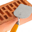 Stock Photo: Plastering trowel and brick