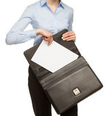 Unrecognizaable businesswoman with documents and briefcase — 图库照片
