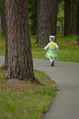 Little girl running away — Stock Photo