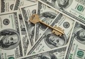 Dollars and key — Stock Photo
