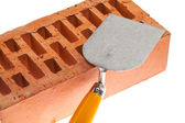 Plastering trowel and a brick — Stock Photo