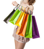 Multicolored paper bags on female hand — Стоковое фото