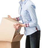 Young woman holding empty cardboard boxes — Stock Photo