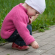 Little girl drawing with a chalk — Stock Photo