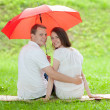 Stock Photo: Happy smiling young couple under red umbrella