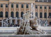 Fountain with sculpture in the square — Stock Photo