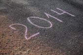 2014 written on asphalt — Stock Photo
