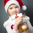 Portrait of a charming little girl in Santa's hat — Stock Photo #36682613