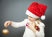 Portrait of a charming little girl in Santa's hat — Stock Photo
