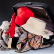 Suitcase and red umbrella — Stock Photo